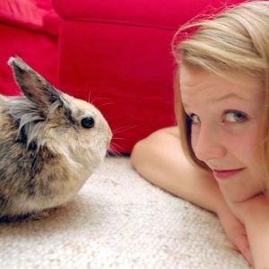 rabbit and girl face to face on floor