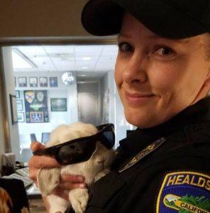 Katie Close holds Officer Speedy