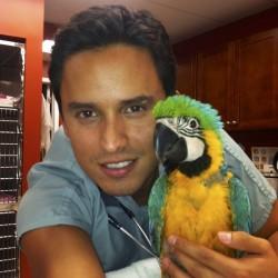 Santiago Diaz w macaw chick